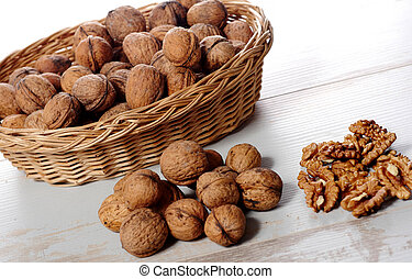 pile of walnuts on a white wooden table