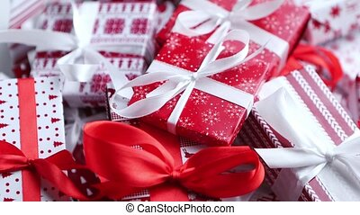 A pile various size wrapped in festive paper boxed gifts placed on stack. Christmas concept. Colorful Xmas style. Top view, flat lay.