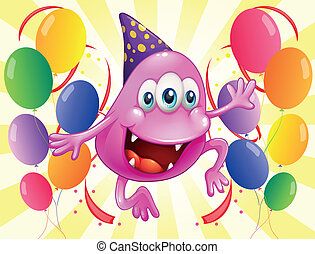 A pink beanie monster in the middle of the balloons