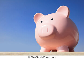 pink piggy bank - A pink piggy bank with blue sky