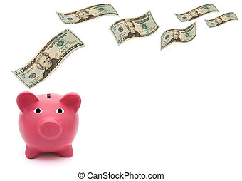Making Money - A pink piggy bank with twenty dollar bills on...