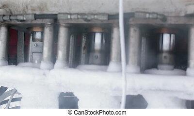 A piston engine on cryogenic equipment. Close up.
