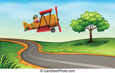 A plane above the winding road