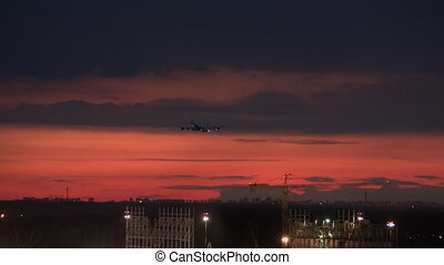 A plane in the red sky