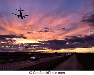 A plane is approaching Stuttgart AIrport during a dramatic...