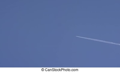 A plane is flying in the sky. Airplane aviation airport...