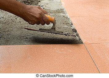 A plasterer is tiling at home, tile