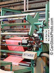 a plastic coating machine inside factory