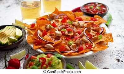 A plate of delicious tortilla nachos with melted cheese...