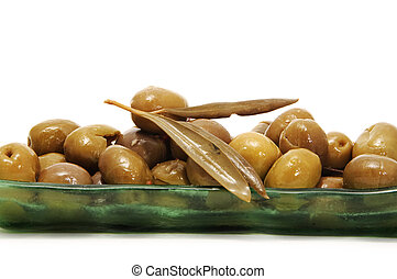 a plate of olives on white background