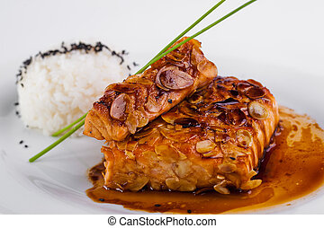 A plate of rice with fish