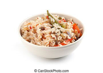 A plate of rice with vegetables