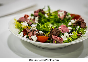 A plate of salad. Meats Vegetables Herbs