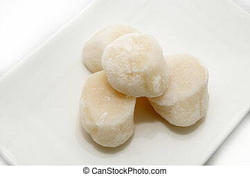 a plate of frozen scallops on a white background