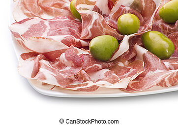 A plate of sliced italian coppa on white
