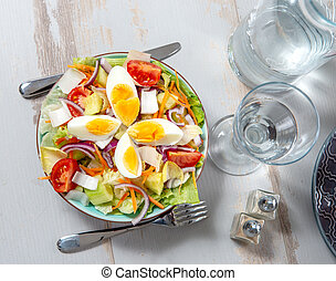 plate of vegetable salad on white wooden table