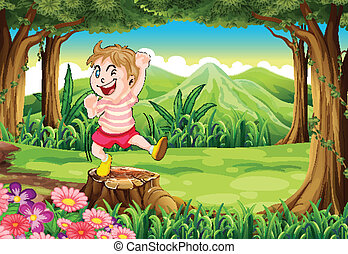 A playful young boy at the forest standing above the stump