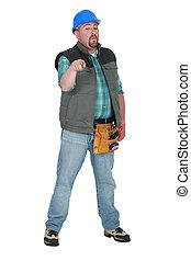 A plumb handyman pointing at the camera.