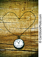 a pocket watch on a wood background