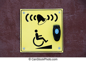 A pointer and a button to call for help for disabled people and people in wheelchairs.