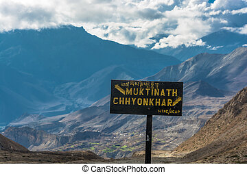A pointer to a fork in the road in Muktinath and Chinchar,...