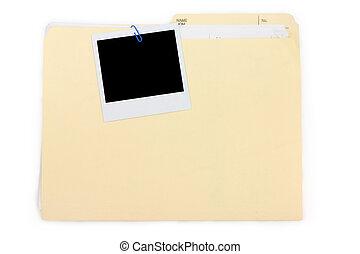 a polaroid photo and file folder, business concept