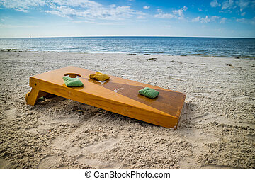 A popular game of Corn Hole in a fine weather at Fort Myers,...