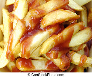 A portion of chips covered sauce