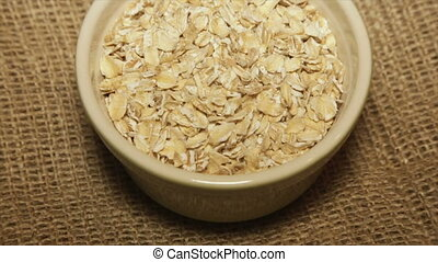 A portion of oatmeal in a bowl. Full hd video