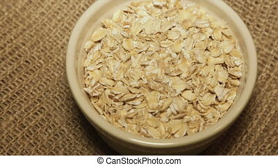 A portion of oatmeal in a bowl. Full hd video - A portion of...