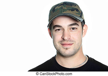 A portrait of a 30 years old men with a cap.