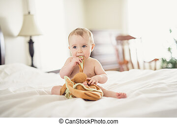 Portrait of a baby on the bed