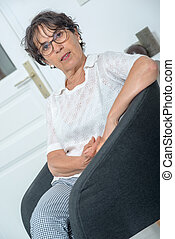 portrait of a beautiful mature woman at home