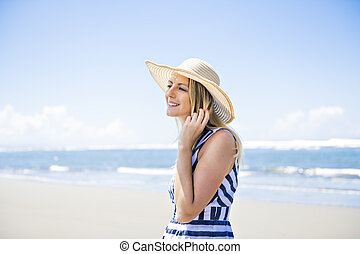 Portrait of a beautiful woman at the beach on day time