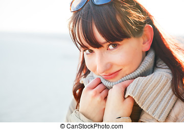 A portrait of a beautiful young woman on a sunny day.