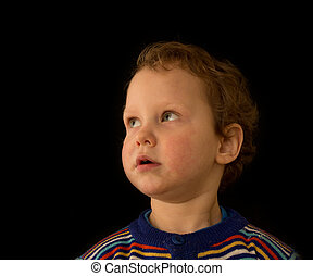 a portrait of a boy on a black background