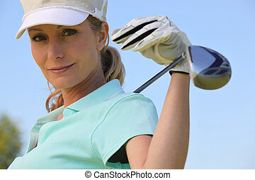 A portrait of a female golfer.