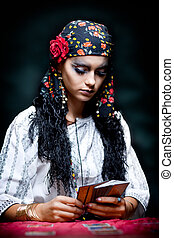 a portrait of a gypsy fortune teller. - a portrait of a...