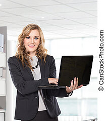 smiling young businesswoman Holding Laptop