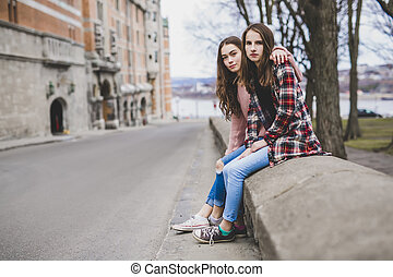 A Portrait of a teen girl with long hair in an urban