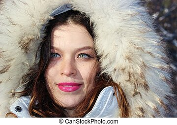woman in a hood with fur