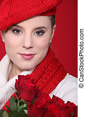 A portrait of a woman with red roses.