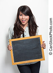 young asian woman holding blank black board