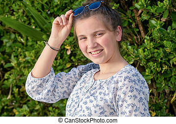 portrait of a young teen girl with sunglasses outdoor