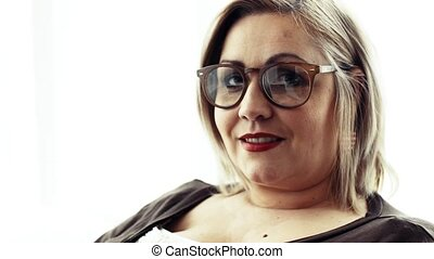 A portrait of an attractive overweight woman at home. Close...