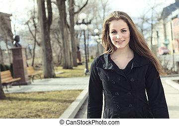 Portrait of beautiful brunette girl walking