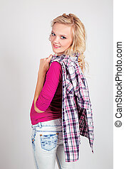 A portrait of beautiful sexy blond woman in a pink shirt holding a black white pink jacket back side