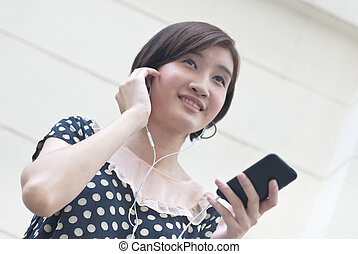 a portrait of beautiful woman listening to music