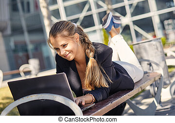 a Portrait of business woman smiling outdoor