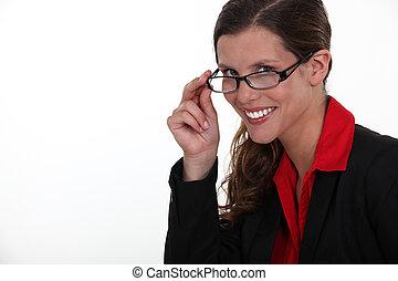 A portrait of businesswoman adjusting her glasses.